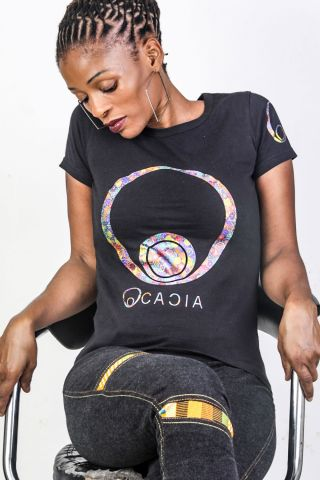 Hippy Chic T-Shirt Taking the Tee to another level, and only for the sisters. Rock this cool multicolored rainbow Ocaica number at set the world on fire. Cut to hug the ladies shape and made from combed cotton. Featuring the beautiful Ocacia logo on the f